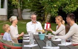Happy family having holiday dinner outdoors Royalty Free Stock Photography
