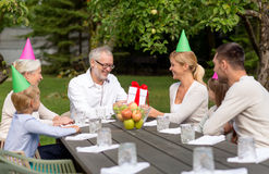 Happy family having holiday dinner outdoors Royalty Free Stock Images