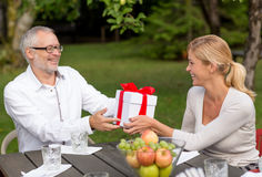 Happy family having holiday dinner outdoors Stock Photography