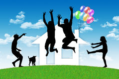 Happy family having a house. Silhouettes of parents, children and their dog jumping in joy in front of their little house made of paper Royalty Free Stock Photos