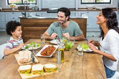 Happy family having lunch together. In kitchen at home Royalty Free Stock Image