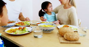 Happy family having meal. At home stock footage