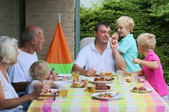 Happy family having meal together Stock Photography