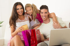 Happy family having online shopping Royalty Free Stock Image