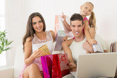 Happy Family Having Online Shopping Stock Photo