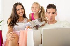 Happy Family Having Online Shopping Royalty Free Stock Image