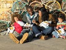 Happy family having picnic. Smiling stock photos
