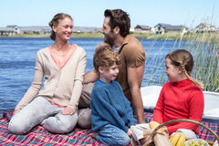 Happy family having picnic at a lake Stock Photography