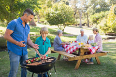 Happy family having picnic in the park. On a sunny day Stock Images