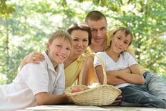 Happy Family having picnic. Portrait  of happy family having picnic in summer Stock Image