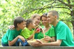 Happy Family having picnic. In summer park Stock Photos