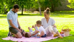 Happy family having picnic at summer park stock video