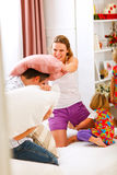 Happy family having pillow fight in bed Royalty Free Stock Images