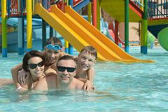 Happy family having  in pool. Happy family having fun in a pool Royalty Free Stock Images