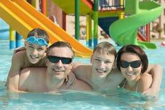 Happy family having  in pool Stock Photo