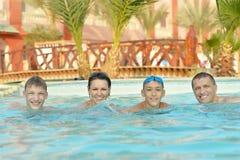 Happy family having  in pool. Happy family having fun in a pool Stock Photos