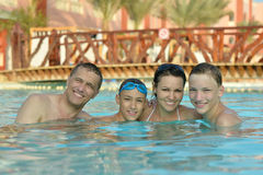 Happy family having  in pool Stock Photography