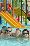 Happy family having  in pool. Happy family together having fun in pool Royalty Free Stock Photo