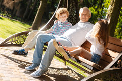 Happy family having rest on the nature Stock Image