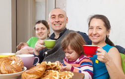 Happy family having tea and cakes Stock Images