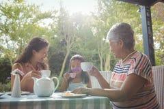 Happy family having tea Stock Photography
