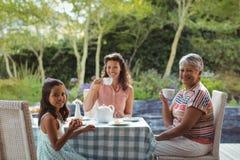 Happy family having tea Stock Photo