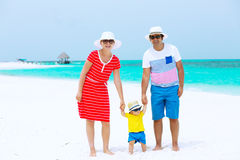 Happy family having tropical vacation Royalty Free Stock Photography