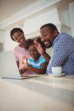 Happy family having a video call on laptop Royalty Free Stock Photos