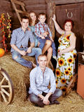 Happy family on a  hayloft Royalty Free Stock Photos