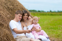 Happy family in haystack or hayrick Stock Photography