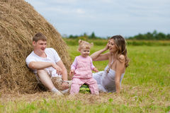 Happy family haystack with watermelon summertime Royalty Free Stock Photo