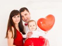 Happy family heart balloon Stock Images