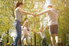 Happy family heaving fun in the meadow. royalty free stock photo