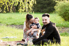 Happy family with her son in the park. Family spending quality time together Stock Images