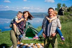 Happy family hiking. Together on a montain lake stock photo