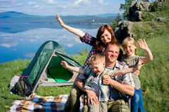 Happy family hiking. Together on a montain lake stock images