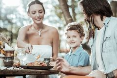 Happy family of hippies eating tasty food