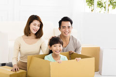 Happy family holding box moving to new home Royalty Free Stock Photo
