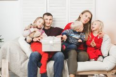 Happy family holding christmas gifts at home.  Royalty Free Stock Photos