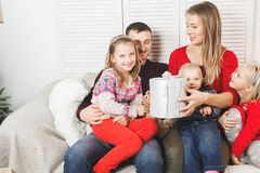 Happy family holding christmas gifts at home.  Stock Photography