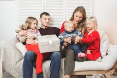 Happy family holding christmas gifts at home.  stock images