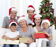 Happy family holding Christmas presents. At home Stock Photography