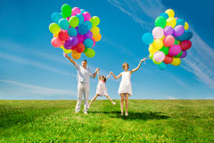 Happy family holding colorful balloons. Mom, ded and two daughte Royalty Free Stock Images