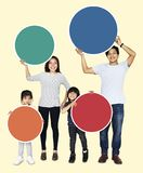 Happy family holding colorful round boards stock photo