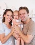 Happy family holding cute baby at home Royalty Free Stock Photography