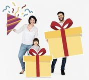 Happy family holding gift box icons stock images