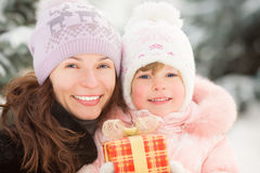 Happy family holding gift box Royalty Free Stock Images