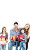 Happy family holding gifts. Royalty Free Stock Photography