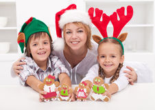 Happy family holding gingerbread peop Stock Photo