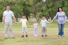 Happy family holding hands Stock Photography